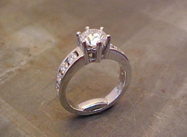 custom solitaire engagement ring with diamond accent band