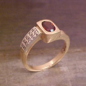 gold ring with ruby gem
