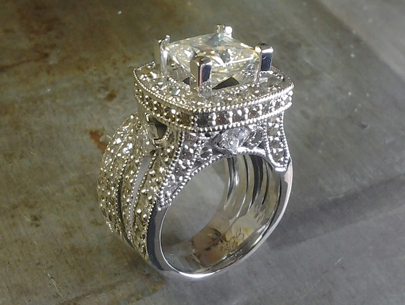 diamond encrusted engagement ring with large center stone side view