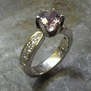 white gold ring with diamonds and purple sapphire