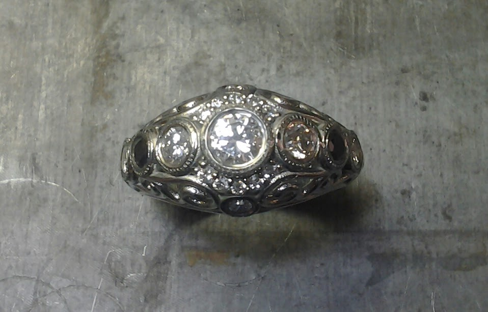 Open style Art deco inspired scroll engagement ring top view bezel