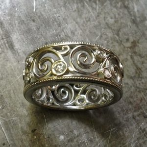 custom scroll wedding band 19k