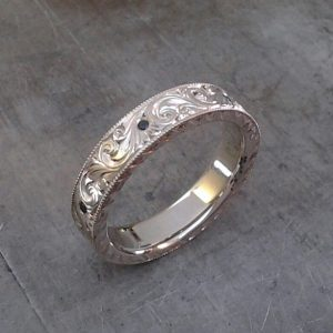 Hand engraved gemstone wedding bands