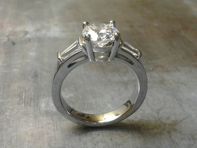 19k Engagement ring with tapered baguette accents