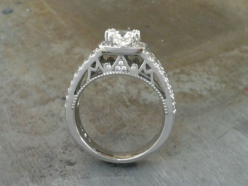 finger through view Cushion Cut 19k Halo Engagement Ring