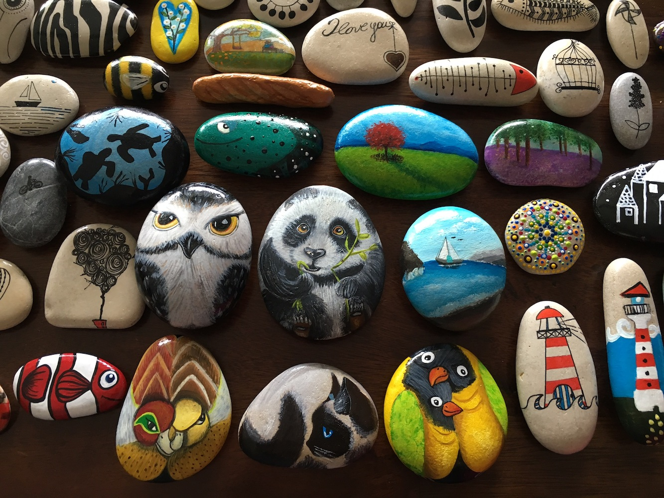 Mini pices of art, handpainted pebbles from Crete in a variety of sizes