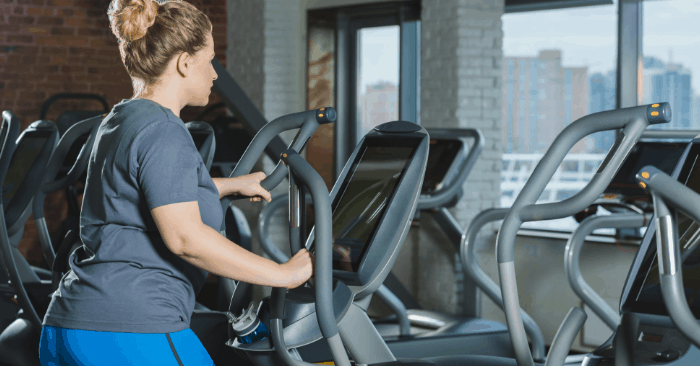 woman over 40 on gym equipment doing a fasted cardio workout