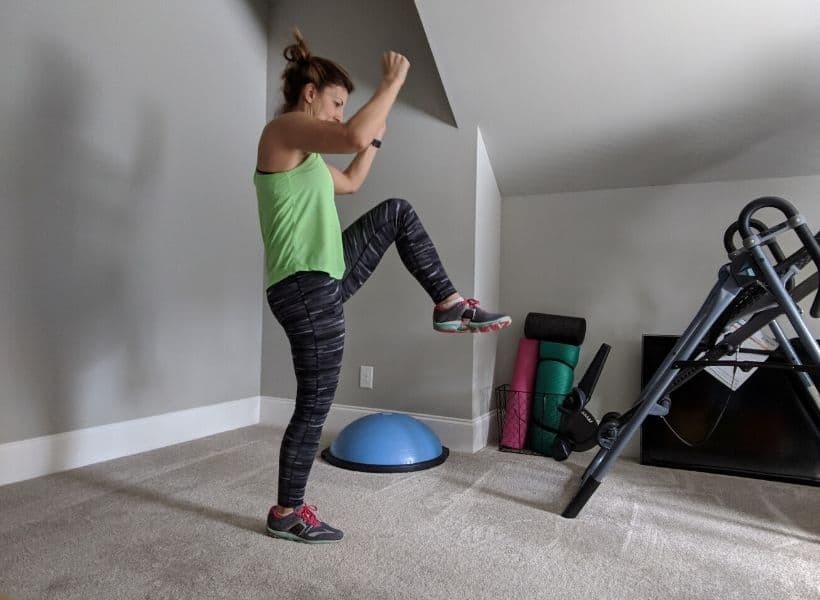 lady exercising standing with leg lifted