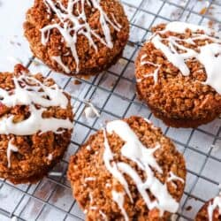 delicious looking easy almond flour pumpkin muffins with streusel on cooking rack