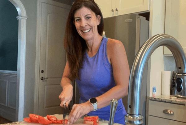 stephanie chopping tomatoes