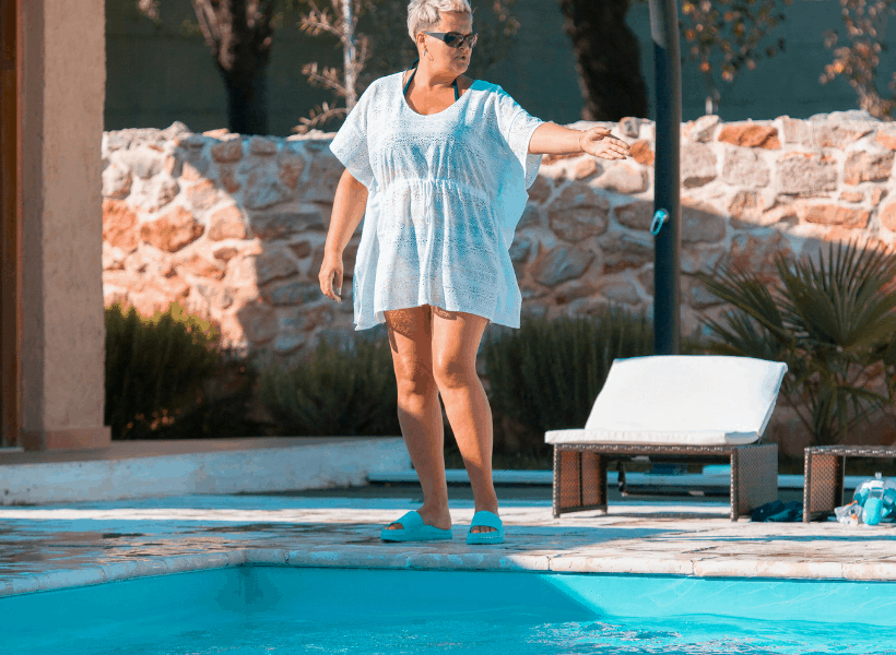 woman standing by pool