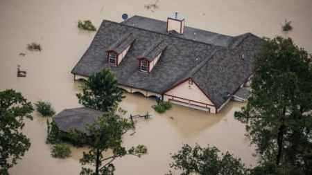 We can t stop hurricanes  Here s how to limit the damage commentary A house sits completely submerged in flood water in the wake of Hurricane  Harvey in Houston