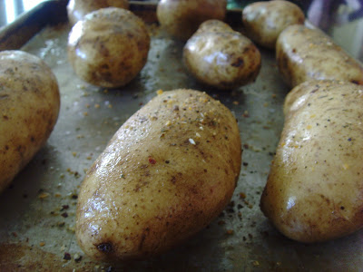 Potatoes on a baking sheet before they go into the oven.