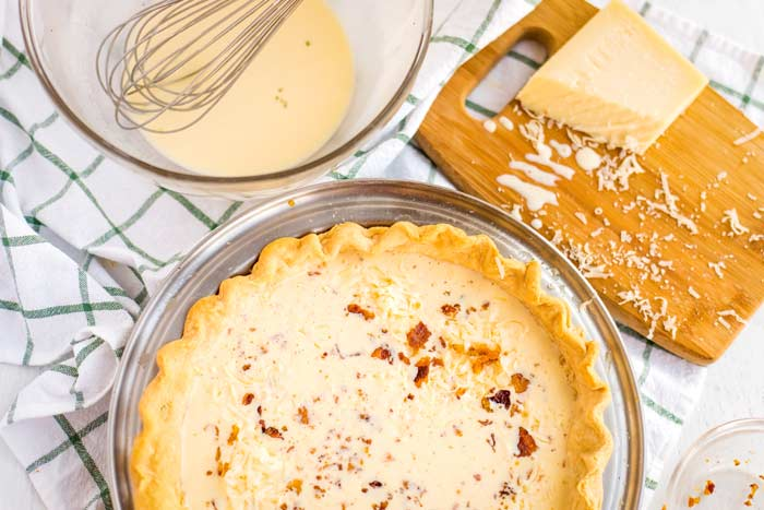 Pour the custard mixture into the prefaced pie shell.