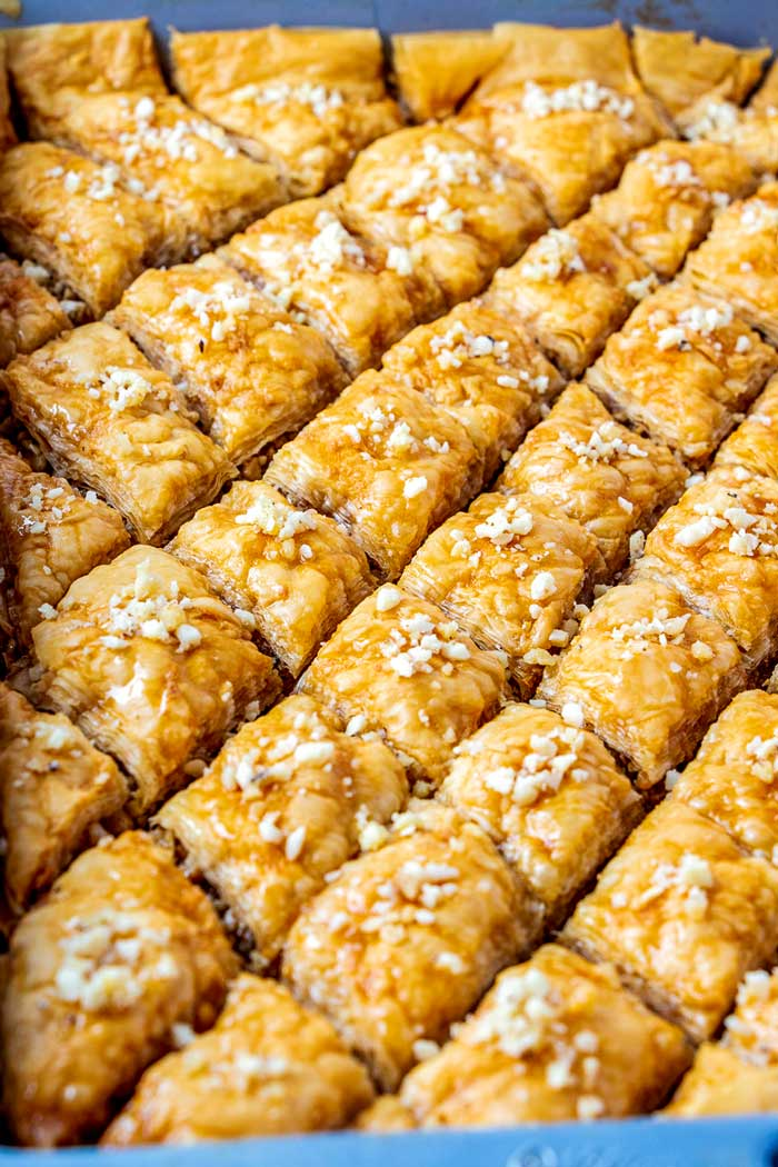 Baklava cut into diamonds in a straight-sided 9 by 13-inch pan.