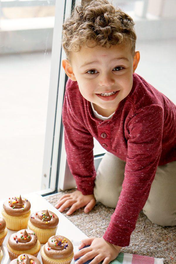 Derek waiting to taste the yellow cupcakes with milk chocolate buttercream