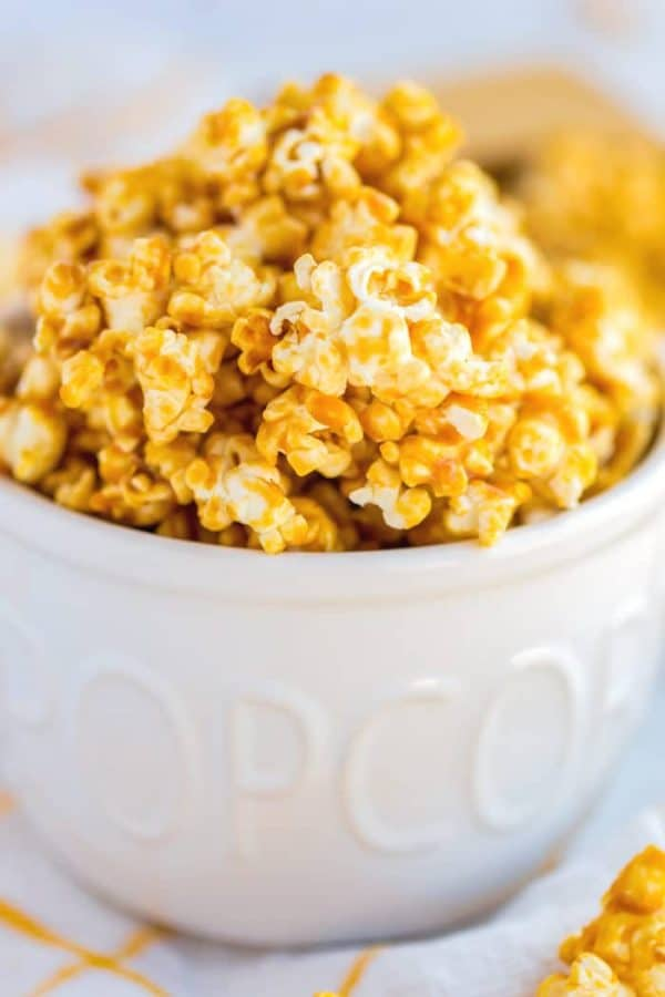 Closeup picture of caramel corn in a popcorn bowl.