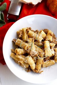 A bowl of Pumpkin Pasta with sausage and sage