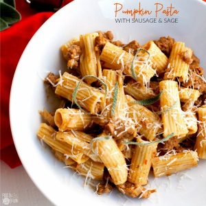 Pumpkin pasta in a bowl with text overlay for Pinterest