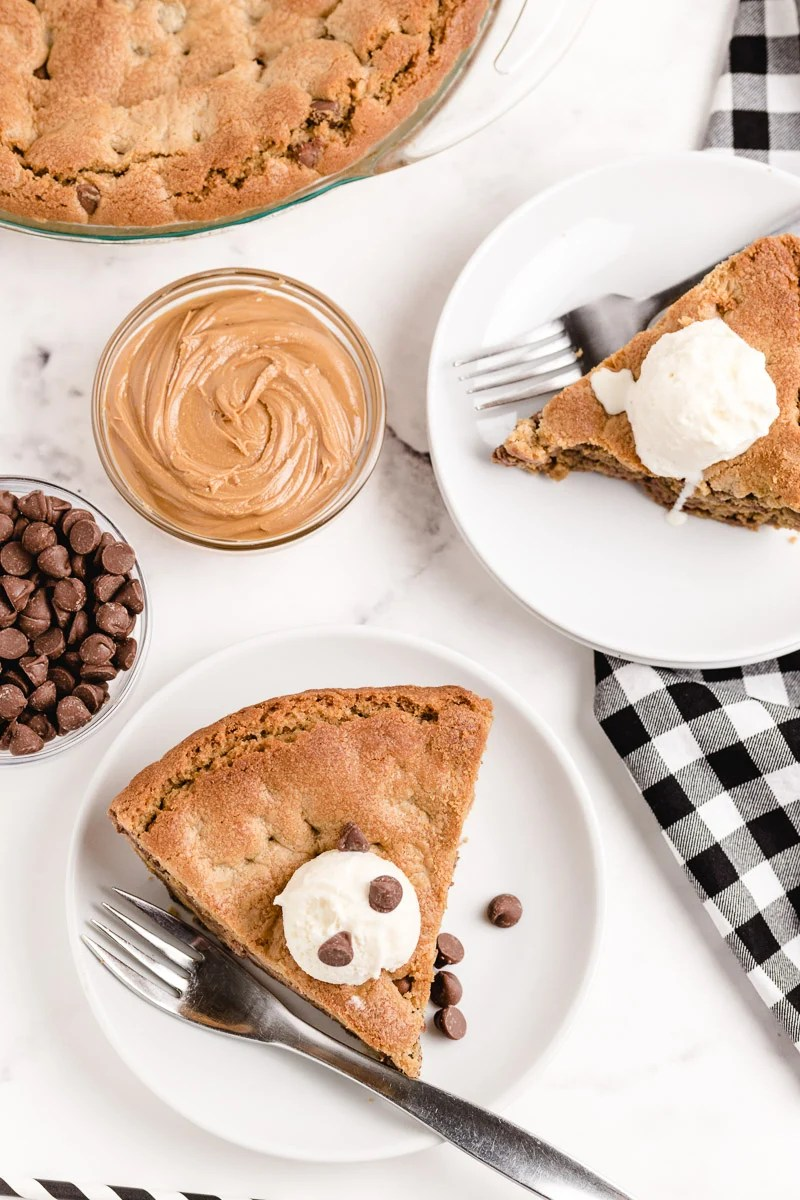 An overhead picture of slices of Peanut Butter Cookie Pie on white plates.