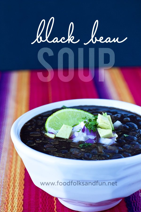 A bowl of black bean soup with text overlay for Pinterest