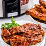 The crockpot spare ribs after they are done cooking with barbecue sauce on them.