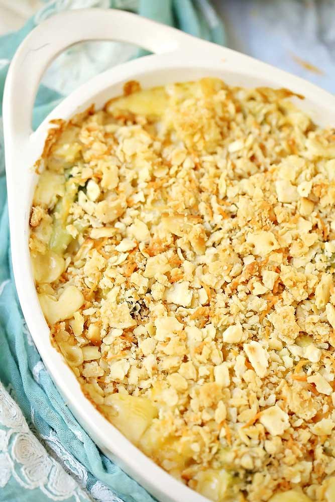Quick & Easy Cheesy Broccoli Cauliflower Casserole in a white serving dish.