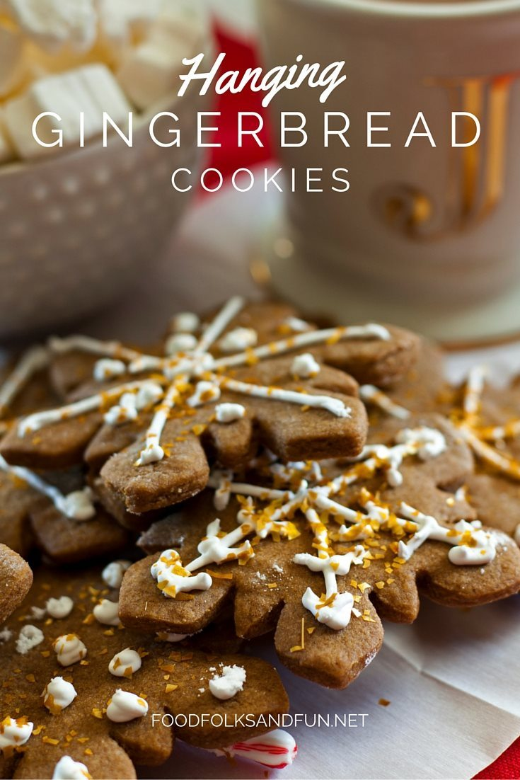 This Hanging Gingerbread Cookies gift is a unique spin on the classic shared over 100 thousand times. Just add a small candy cane to the back and hang the cookies from a cup of cocoa! This recipe has been shared over 100,000 times!  via @foodfolksandfun