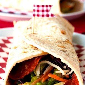A close up of a Pizzeria Salad Wrap