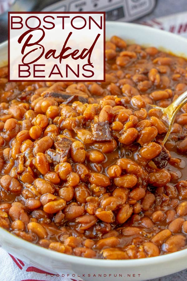 A spoon listing up some of the baked beans.