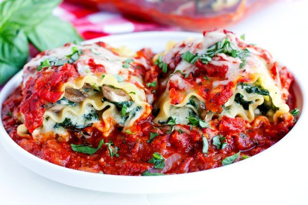 A plate of Lasagna Roll-ups with Mushrooms and Spinach