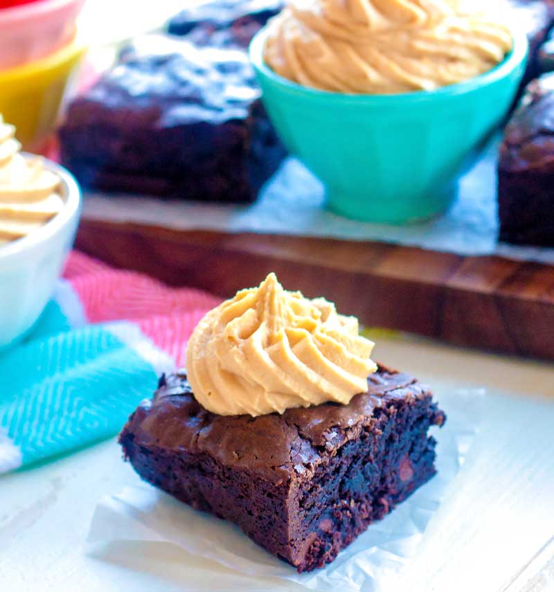 Peanut butter frosting for brownies piped onto a brownie.