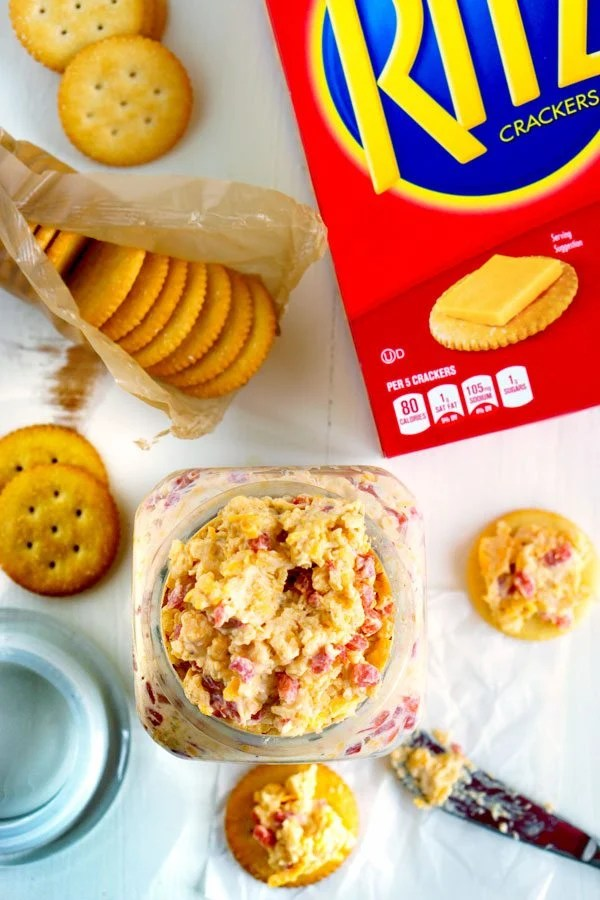 Pimento Cheese Dip in a container with crackers to dip in it