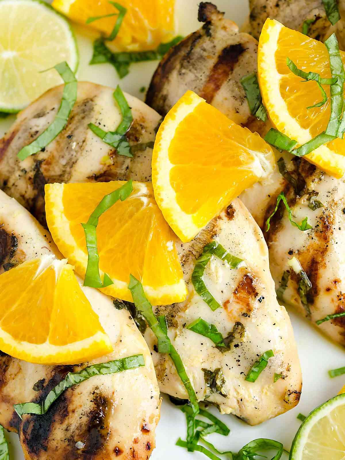 Citrus basil grilled chicken on a serving platter