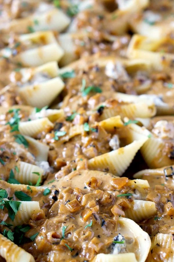 Pasta shells stuffed with ricotta, chicken, pancetta, and cheese. They're covered with a Creamy Marsala Sauce.