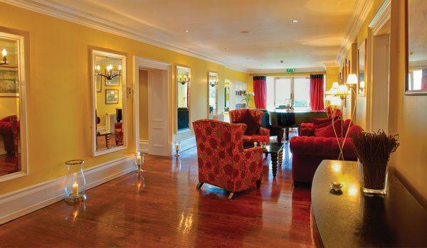 The Lodge at Ashford Castle yellow hallway 1