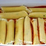 Nestle the manicotti into the baking dish.