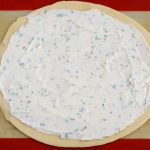 Spread the herbed goat cheese out evenly over the pie crust.