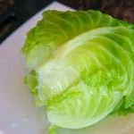 Place the cabbage head on a cutting board to cool.