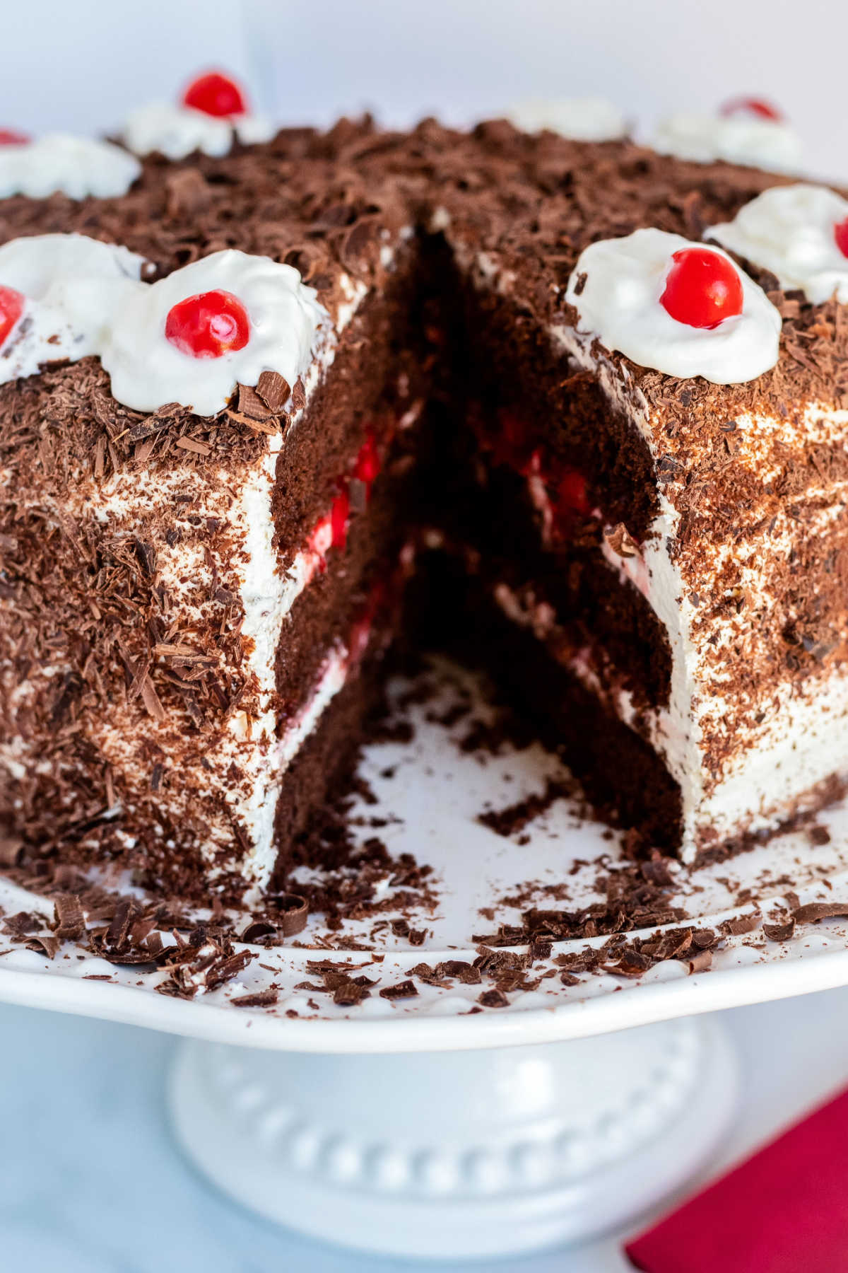 This homemade Black Forest Cherry Cake is a bakery-quality dessert that folks rave about! It's a cake you can serve for Christmas, birthdays, or anytime! via @foodfolksandfun
