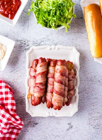 An overhead picture of Bacon Wrapped Hot Dogs on a white platter.