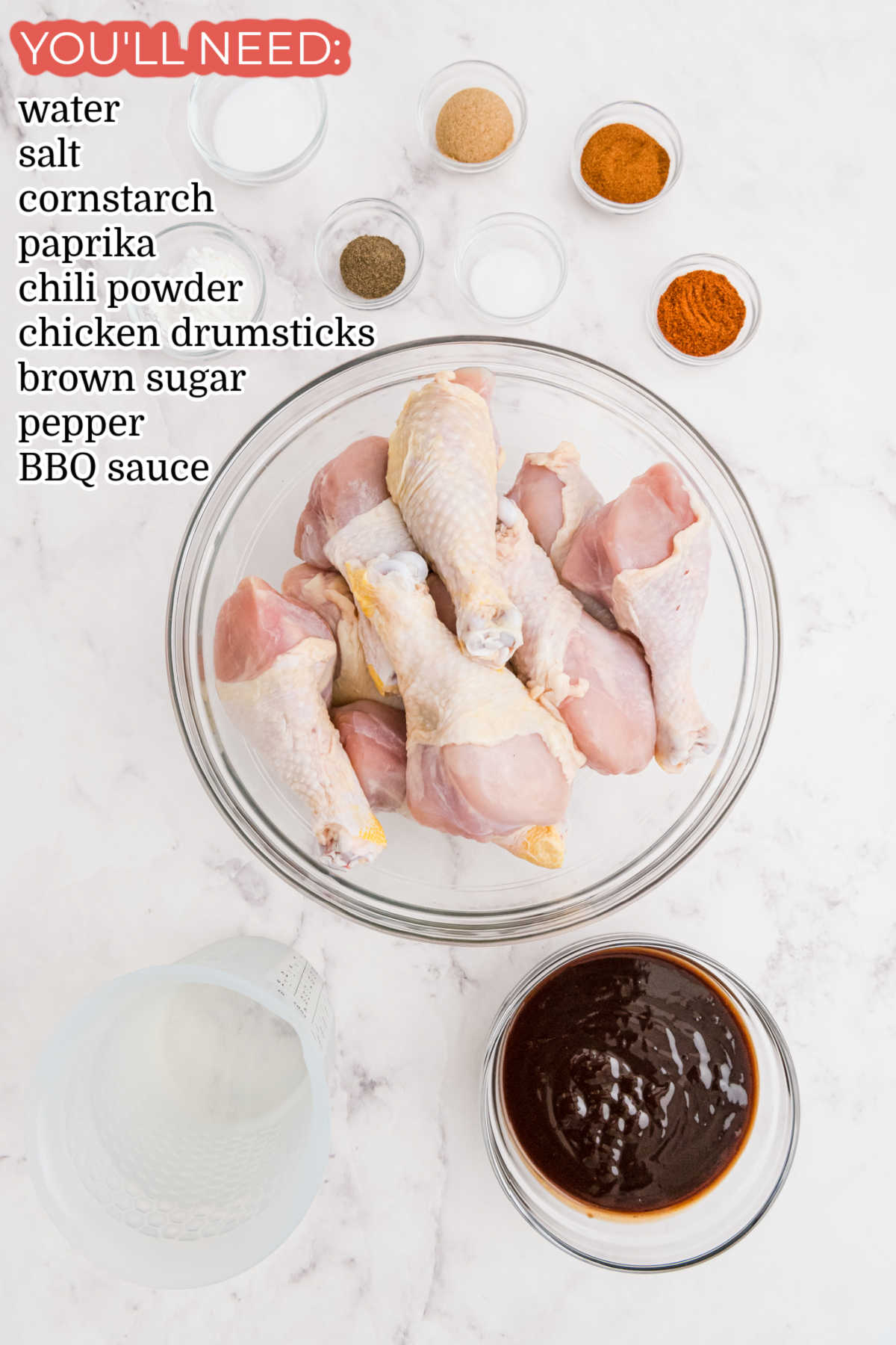An overhead picture of all of the ingredients needed to make Baked BBQ Chicken Drumsticks.