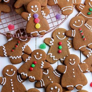 An overhead picture of simply decorated soft gingerbread cookies cutout as gingerbread men and gingerbread women.