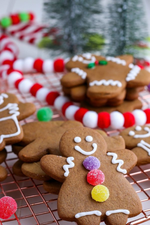 A close up picture of a decorated soft gingerbread cookie.