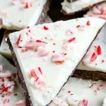 A close up picture of a triangular piece of peppermint bark.