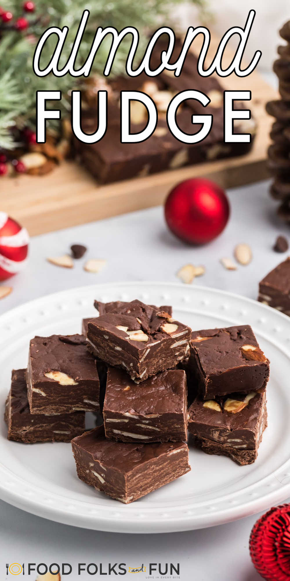 This Easy Chocolate Fudge recipe is studded with almonds and simple to make. All you need are just four ingredients to make this easy fudge!  via @foodfolksandfun