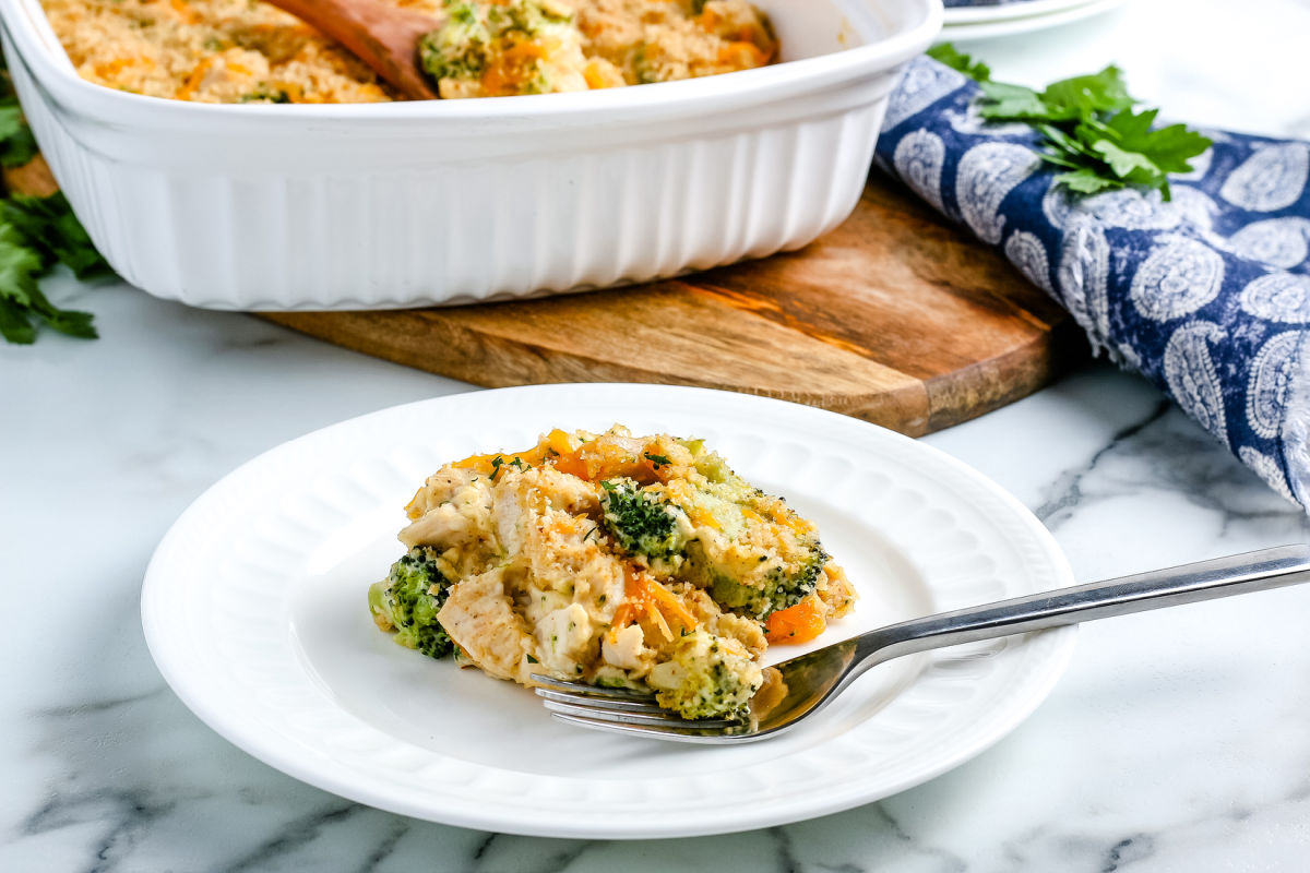 Chicken Divan with Broccoli on a white plate with a fork.