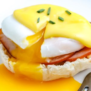 A close up picture of finished Eggs Benedict.