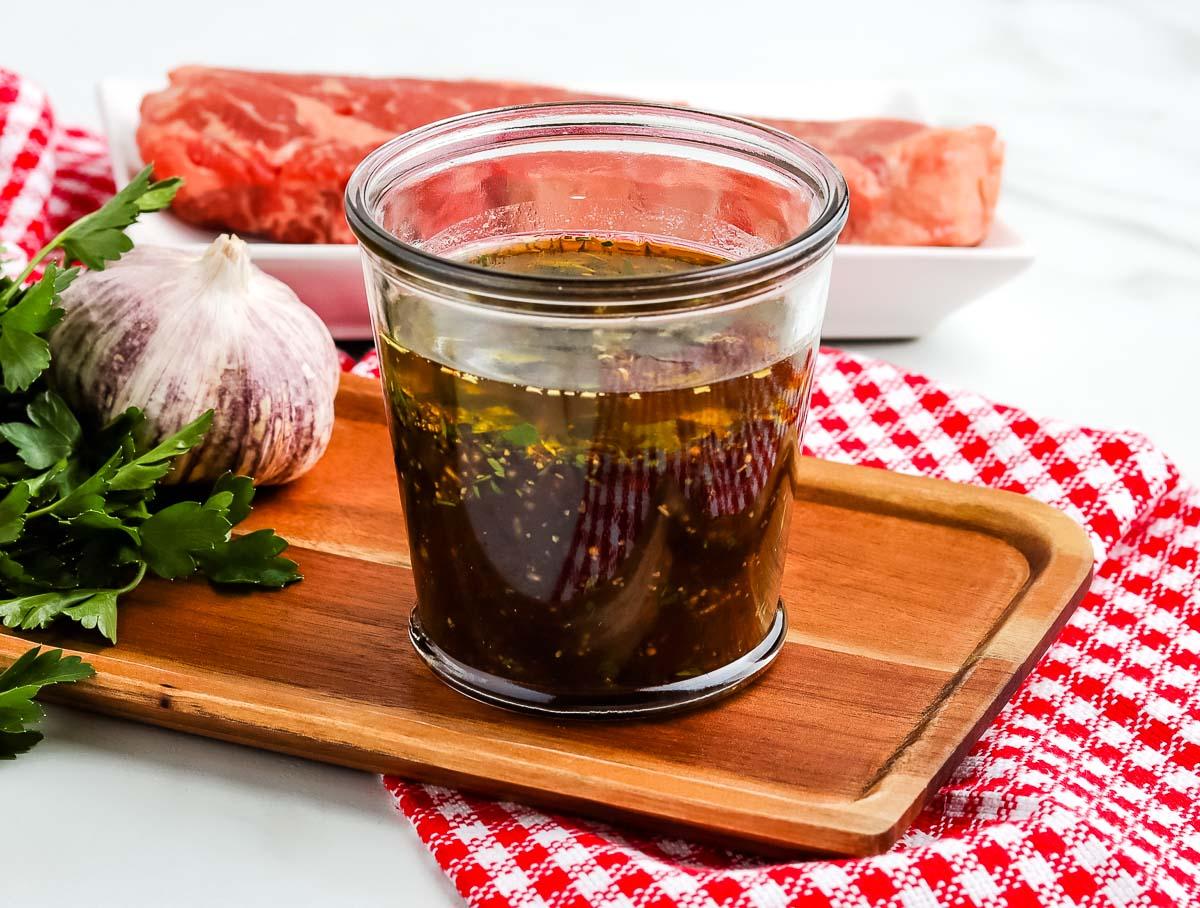 Steak marinade in a clear glass jar.