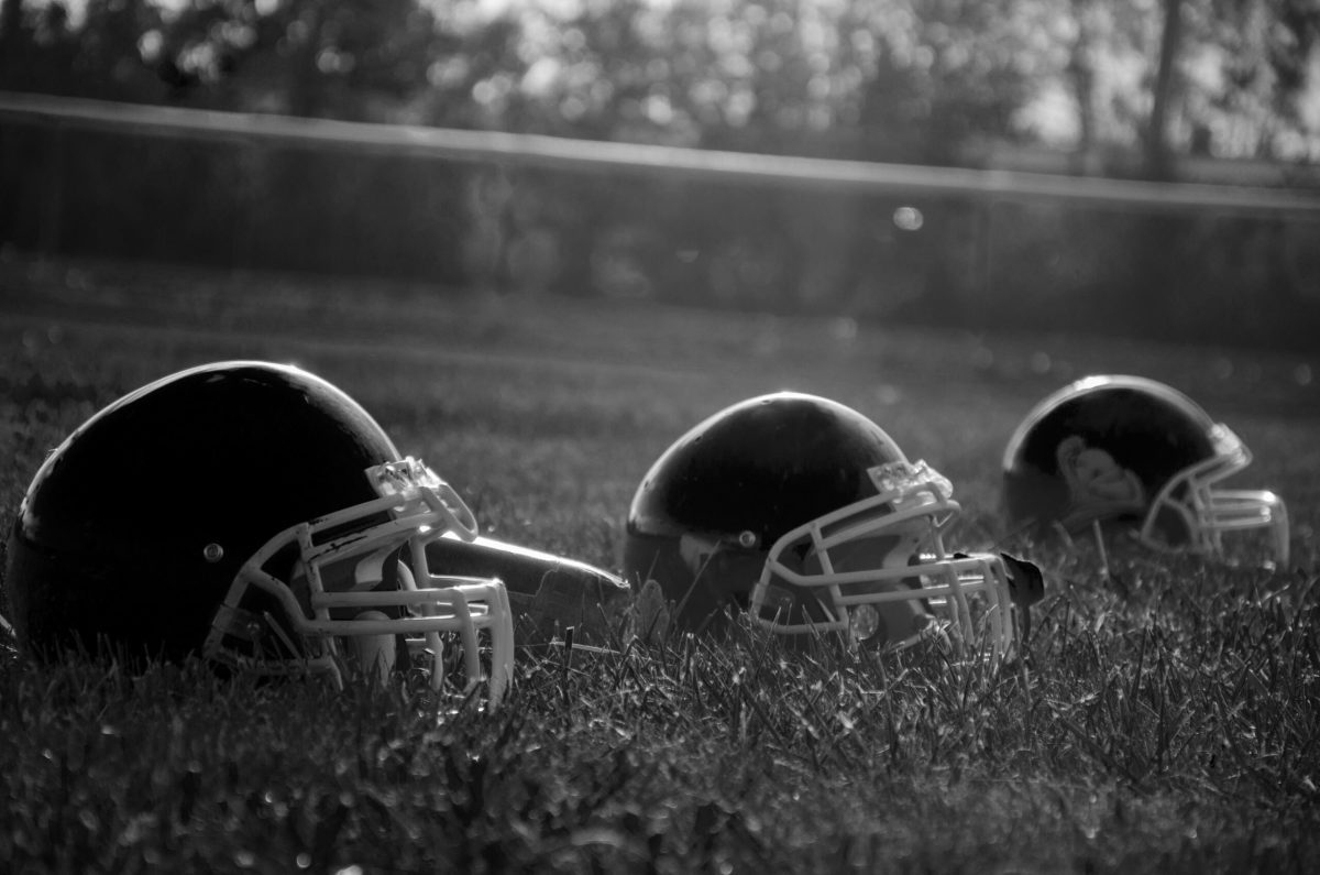Black And White Football Players Field